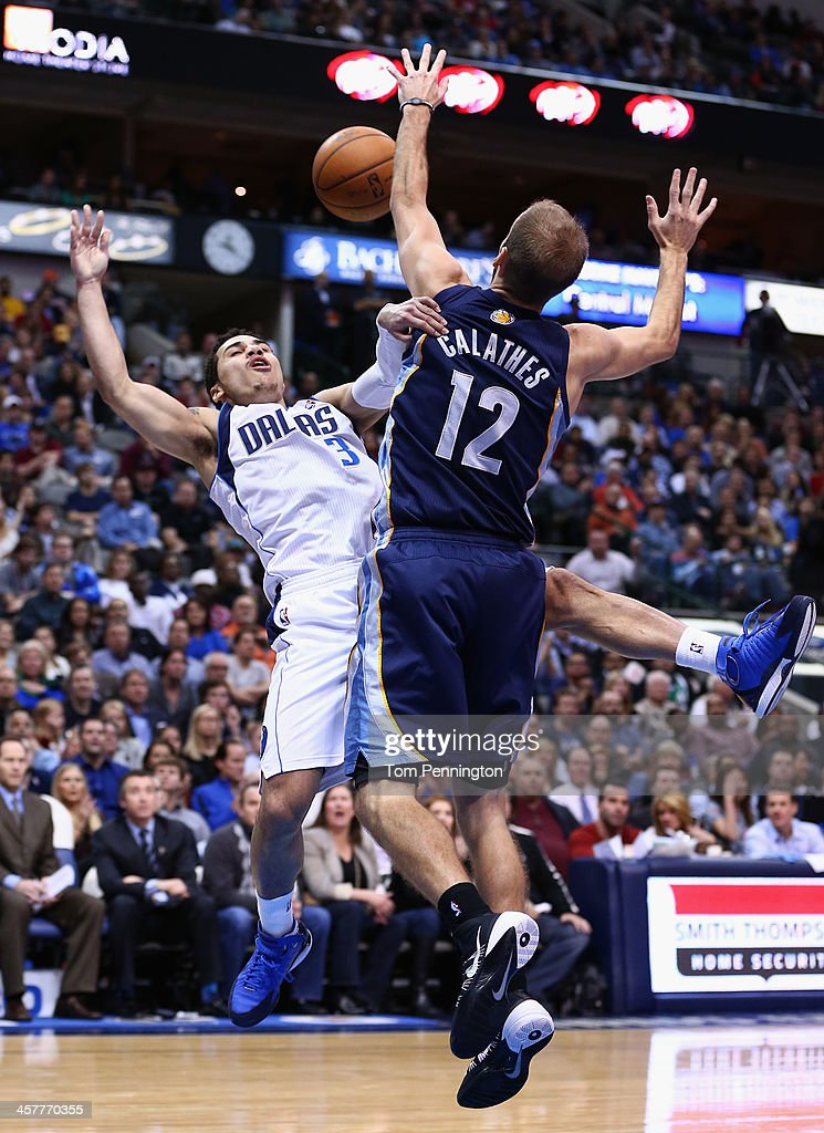 Shane Larkin #3 of the Dallas Mavericks drives to the basket against Nick Calathes #12 of the Memphis Grizzlies at American Airlines Center on December 18, 2013 in Dallas, Texas.