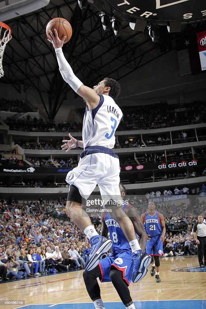 Shane Larkin of the Dallas Mavericks glides in for the layup and what would be his first career NBA field goal against Tony Wroten of the...