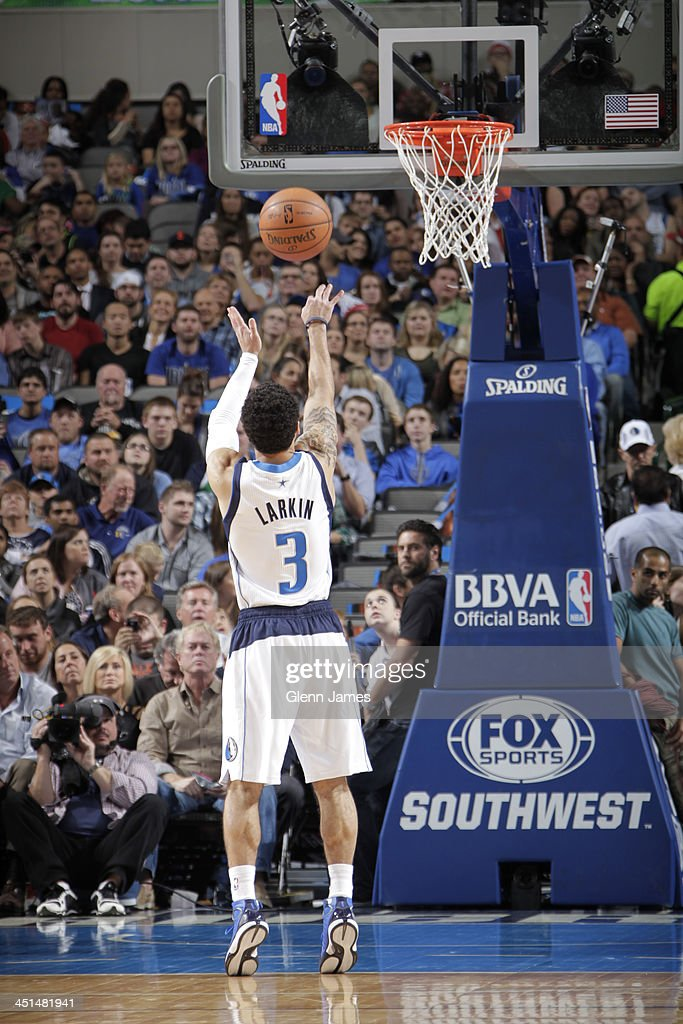 <a gi-track='captionPersonalityLinkClicked' href=/galleries/search?phrase=Shane+Larkin&family=editorial&specificpeople=8641079 ng-click='$event.stopPropagation()'>Shane Larkin</a> #3 of the Dallas Mavericks shoots the ball against the Philadelphia 76ers on November 18, 2013 at the American Airlines Center in Dallas, Texas.