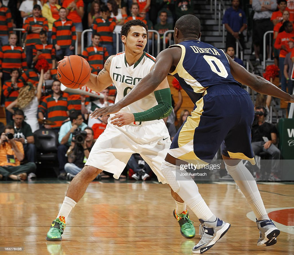 Shane Larkin #0 of the Miami Hurricanes brings the ball up court against Mfon Udofia #0 of the Georgia Tech Yellow Jackets on March 6, 2013 at the BankUnited Center in Coral Gables, Florida.