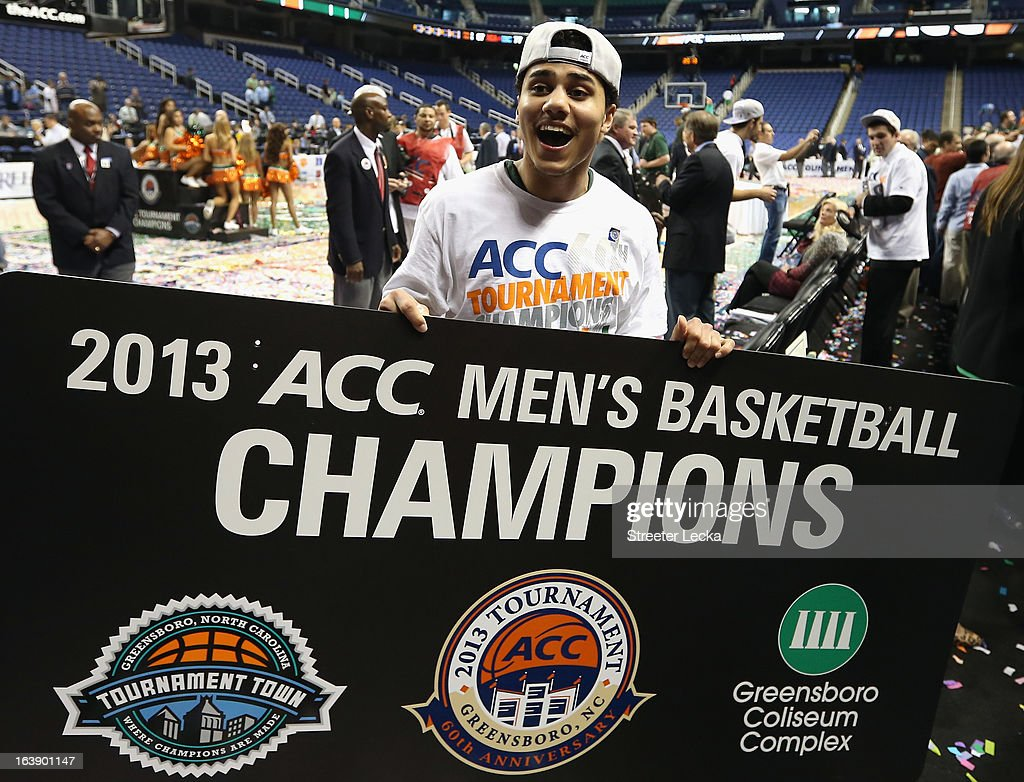 Shane Larkin #0 of the Miami Hurricanes celebrates after defeating the North Carolina Tar Heels 87-77 during the finals of the Men's ACC Basketball Tournament at Greensboro Coliseum on March 17, 2013 in Greensboro, North Carolina.