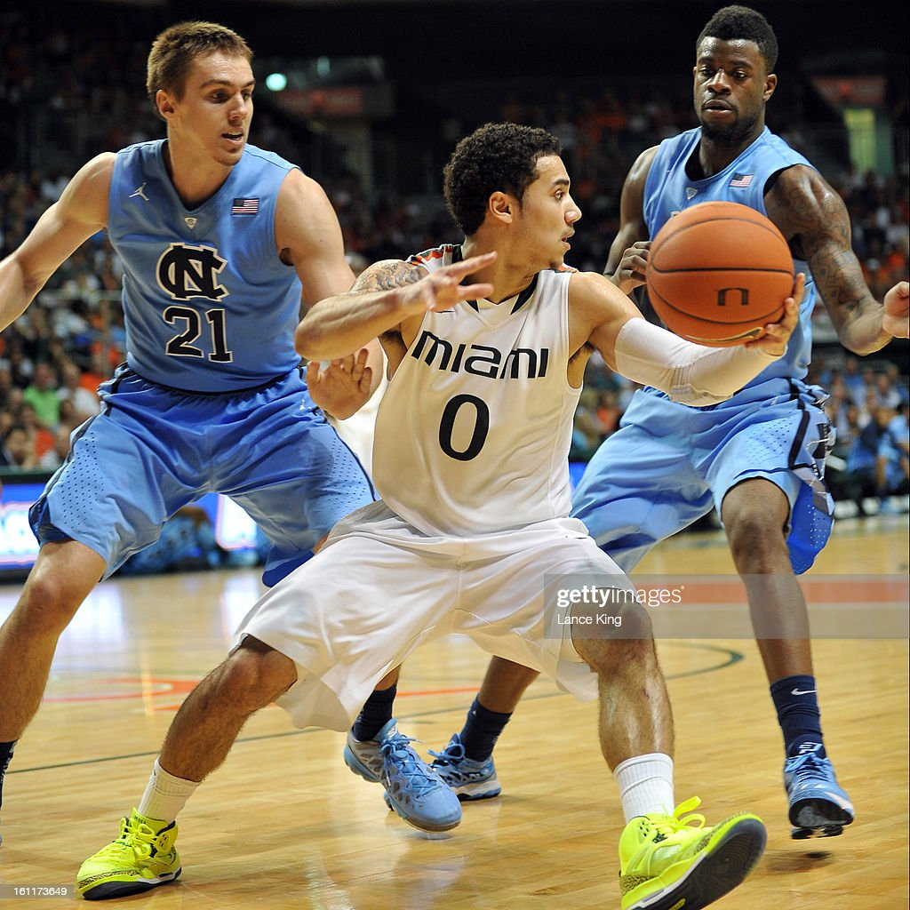 Shane Larkin #0 of the Miami Hurricanes controls the ball against Jackson Simmons #21 and Reggie Bullock #35 of the North Carolina Tar Heels at the BankUnited Center on February 9, 2013 in Coral Gables, Florida. Miami defeated North Carolina 87-61.