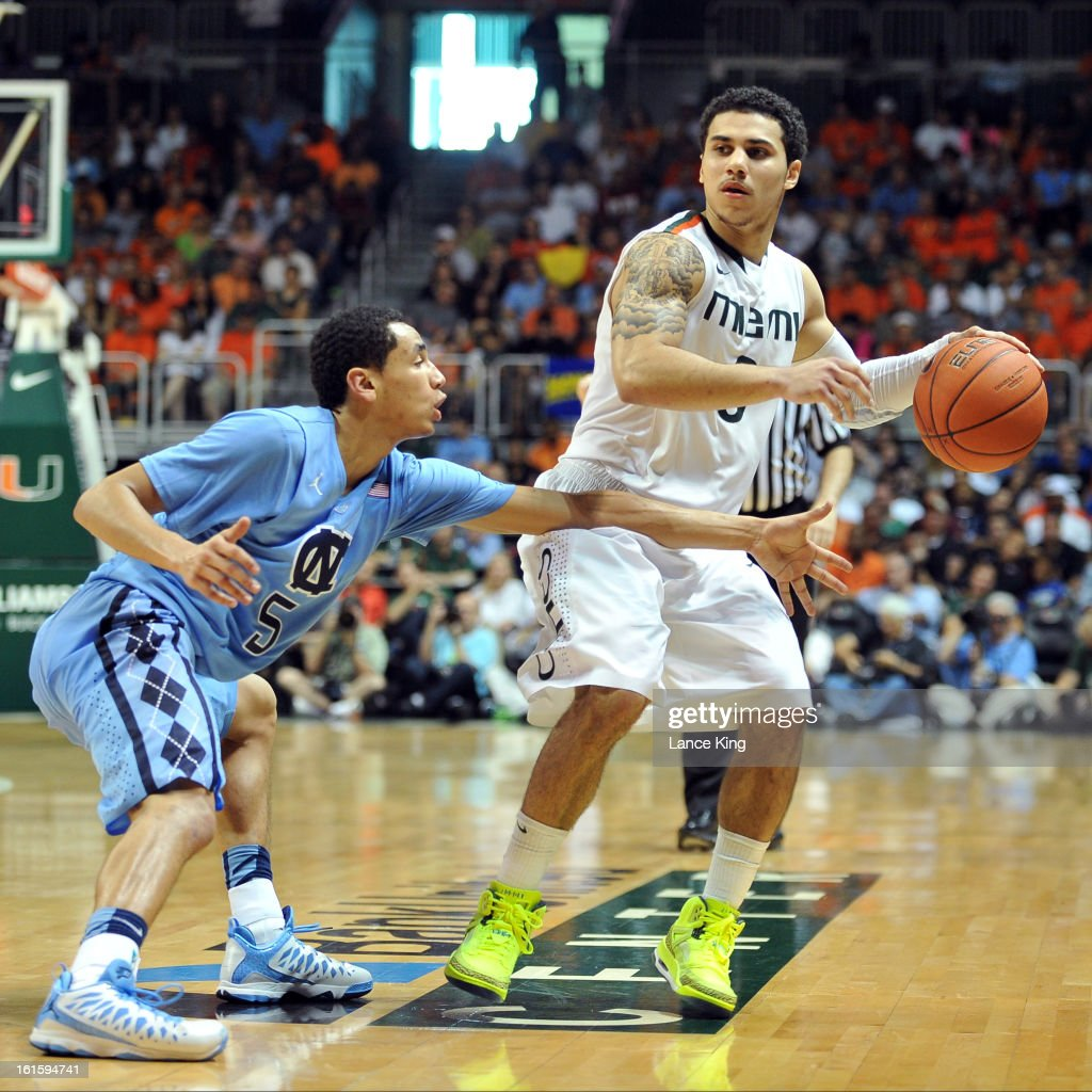 Shane Larkin #0 of the Miami Hurricanes controls the ball against Marcus Paige #5 of the North Carolina Tar Heels at the BankUnited Center on February 9, 2013 in Coral Gables, Florida. Miami defeated North Carolina 87-61.