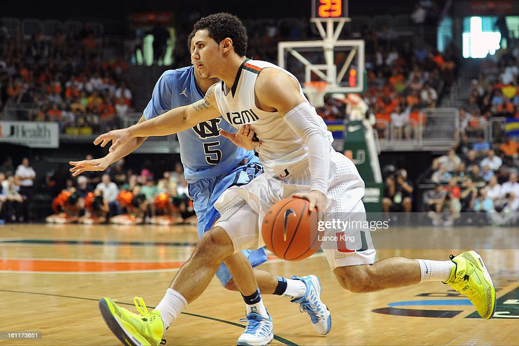 Shane Larkin #0 of the Miami Hurricanes dribbles against Marcus Paige #5 of the North Carolina Tar Heels at the BankUnited Center on February 9, 2013 in Coral Gables, Florida. Miami defeated North Carolina 87-61.