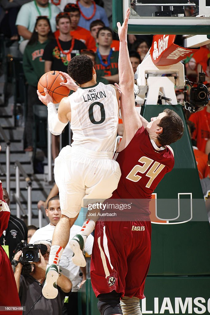 Shane Larkin #0 of the Miami Hurricanes goes to the basket against Dennis Clifford #24 of the Boston College Eagles on February 5, 2013 at the BankUnited Center in Coral Gables, Florida. The Hurricanes defeated the Eagles 72-50.