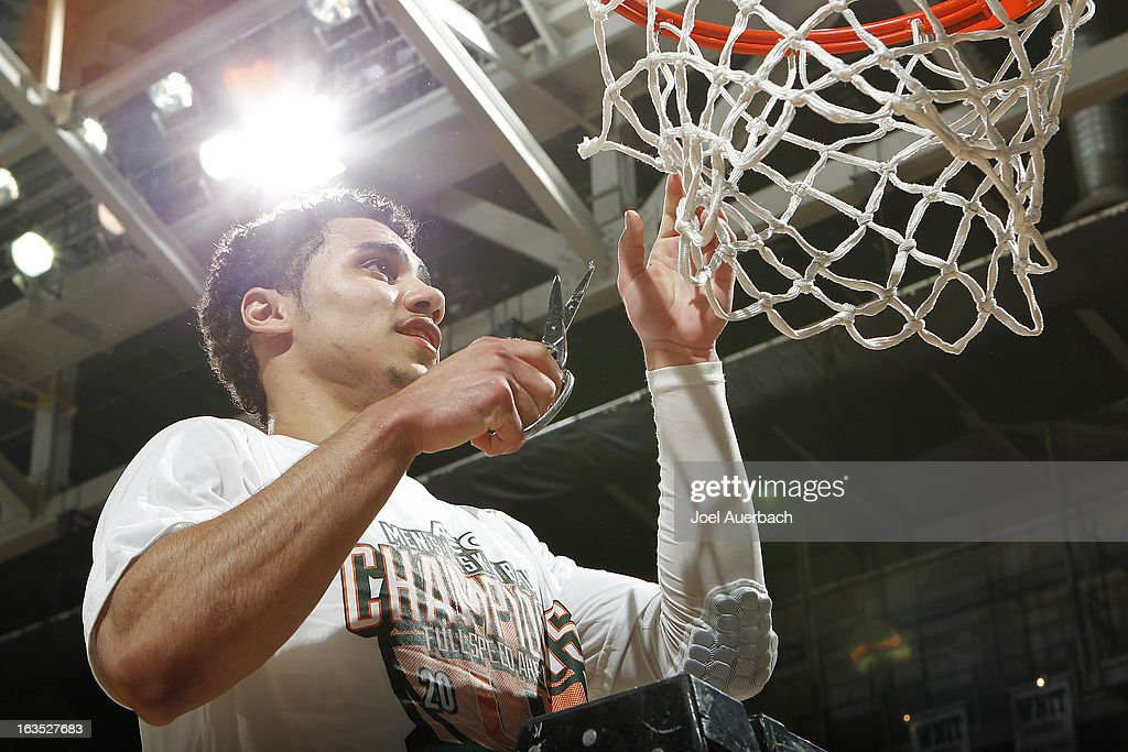 Shane Larkin #0 of the Miami Hurricanes helps cut the net down as part of the celebration after the game against the Clemson Tigers on March 9, 2013 at the BankUnited Center in Coral Gables, Florida. The Hurricanes defeated the Tigers 62-49 and won the Atlantic Coast Conference Championship.