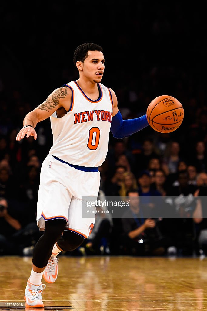 Shane Larkin of the New York Knicks dribbles down the court during a game against the Toronto Raptors at Madison Square Garden on October 13 2014 in...