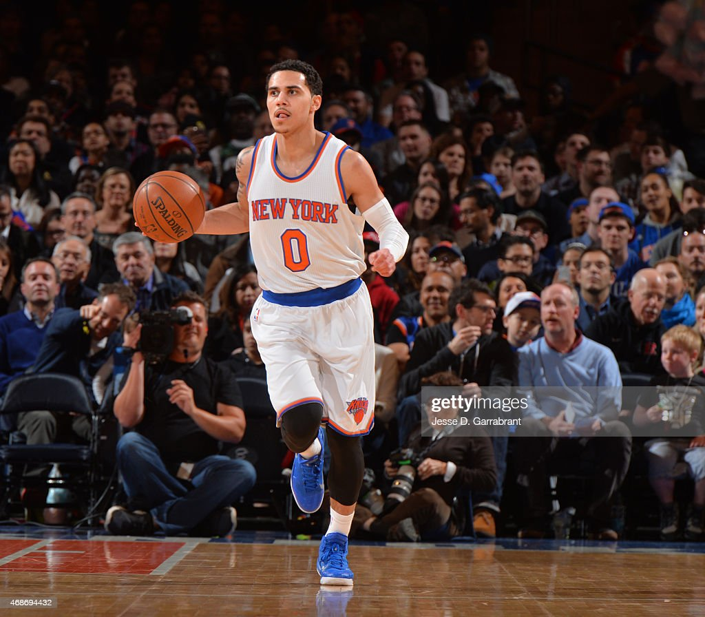 Shane Larkin of the New York Knicks dribbles up court against the Philadelphia 76ers at Madison Square Garden on April 5 2015 in New York New York...