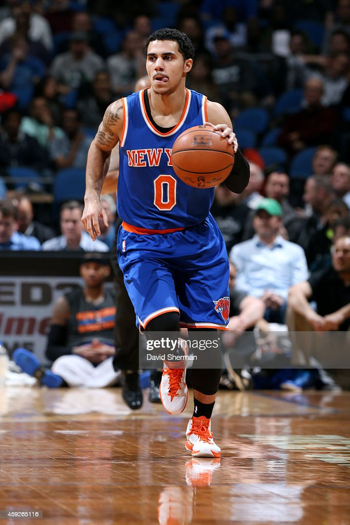 Shane Larkin of the New York Knicks drives against the Minnesota Timberwolves on November 19 2014 at Target Center in Minneapolis Minnesota NOTE TO...