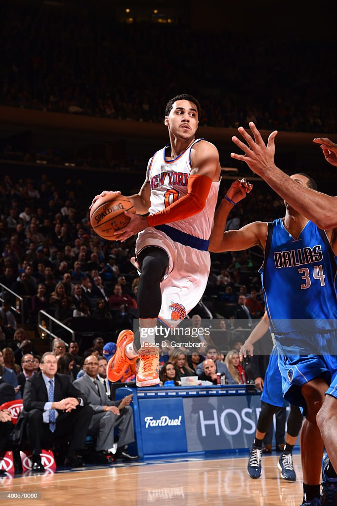 <a gi-track='captionPersonalityLinkClicked' href=/galleries/search?phrase=Shane+Larkin&family=editorial&specificpeople=8641079 ng-click='$event.stopPropagation()'>Shane Larkin</a> #0 of the New York Knicks looks to pass the ball in mid-air against the Dallas Mavericks on December 16, 2014 at Madison Square Garden in New York, NY.