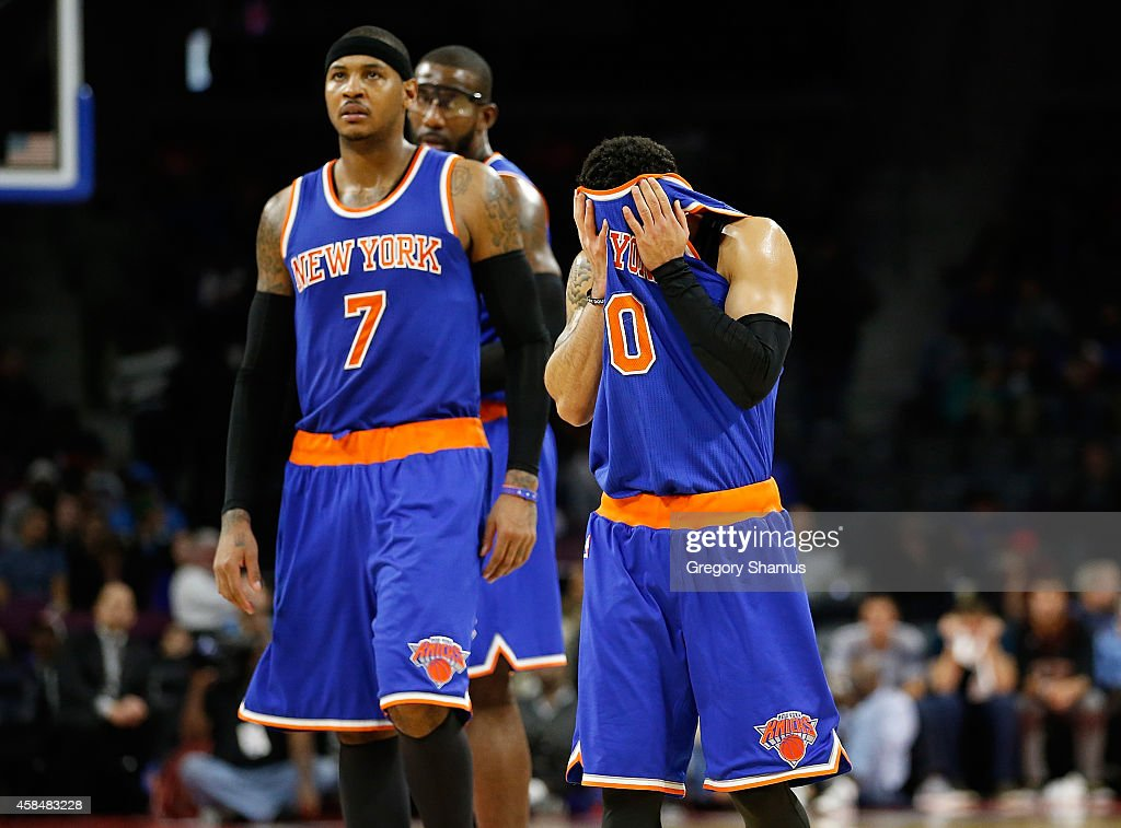 Shane Larkin #0 of the New York Knicks reacts after a late fourth quarter turnover next to Carmelo Anthony #7 while playing the Detroit Pistons at the Palace of Auburn Hills on November 5, 2014 in Auburn Hills, Michigan.