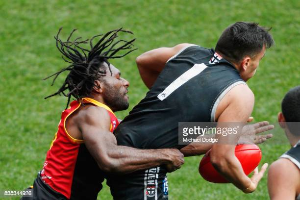 Shane LEAT of New Zealand is tackled during the 2017 AFL International Cup Grand FInal match between New Zealand and Papua New Guinea at Melbourne...