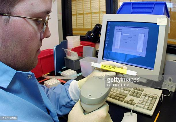 Shane Lefler a lab technician for Myriad Genetics of Salt Lake City Utah scans an individual DNA sample from the New York State Police 20 September...