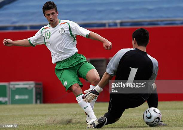 Shane Long of Ireland get the ball past Hugo Suarez of Boliva but still misses the net in the first half on May 26 2007 at Gillette Stadium in...