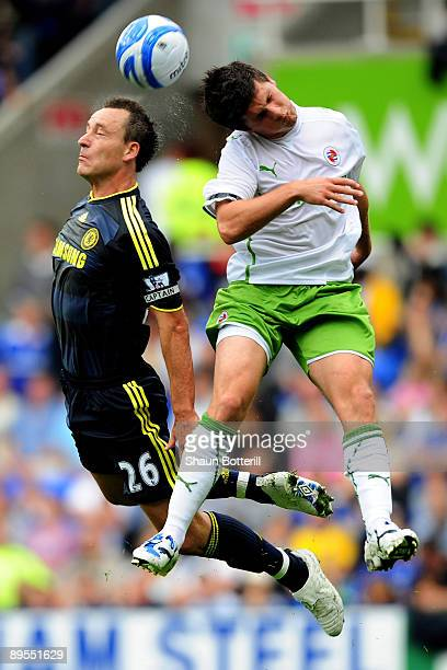 Shane Long of Reading is challenged by John Terry of Chelsea during the preseason friendly match between Reading and Chelsea at the Madejski Stadium...