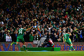 Shane Long of Republic of Ireland celebrates scoring the opening goal in front of the fans during the UEFA EURO 2016 Qualifier group D match between...