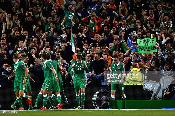 Shane Long of Republic of Ireland celebrates scoring the opening goal team mates in front of the fans during the UEFA EURO 2016 Qualifier group D...