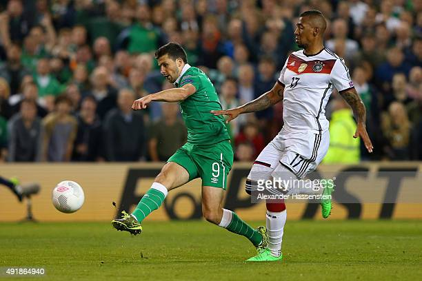 Shane Long of Republic of Ireland scores the opening goal under pressure from Jerome Boateng of Germany during the UEFA EURO 2016 Qualifier group D...