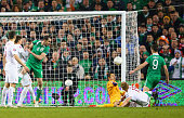 Shane Long of Republic of Ireland scores their first goal past Lukasz Fabianski of Poland during the EURO 2016 Qualifier match between Republic of...