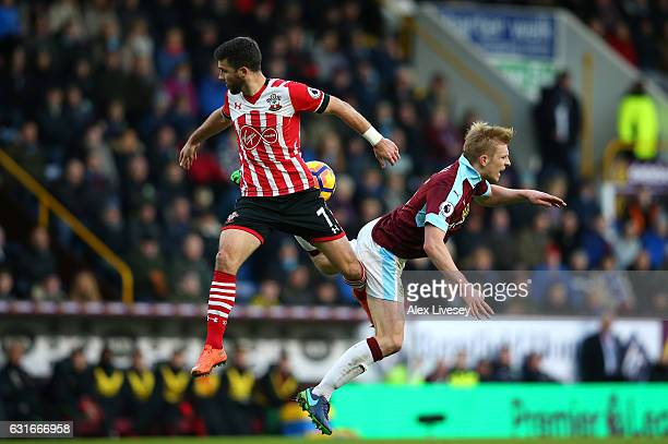 Shane Long of Southampton and Ben Mee of Burnley battle to win a header during the Premier League match between Burnley and Southampton at Turf Moor...