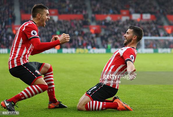 Shane Long of Southampton cekebrates scoring the opening goal with his team mate Dusan Tadic during the Premier League match between Southampton and...