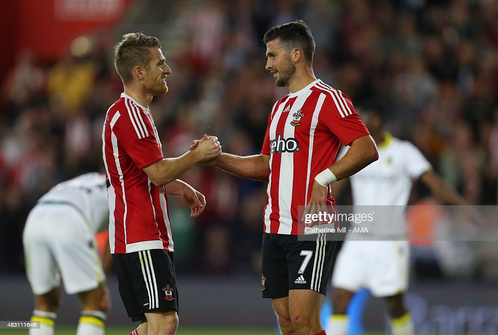 Shane Long of Southampton celebrates after he scores to make it 3-0 with Steven Davies of Southampton during the UEFA Europa League Qualifier between Southampton and Vitesse at St Mary's Stadium on July 30, 2015 in Southampton, England.