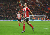 Shane Long of Southampton celebrates as he scores their fourth goal during the Barclays Premier League match between Southampton and Arsenal at St...