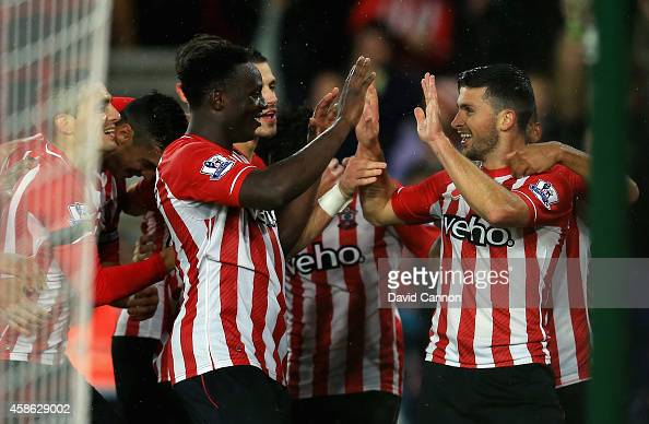 Shane Long of Southampton celebrates scoring a goal with Victor Wanyama of Southampton during the Barclays Premier League match between Southampton...