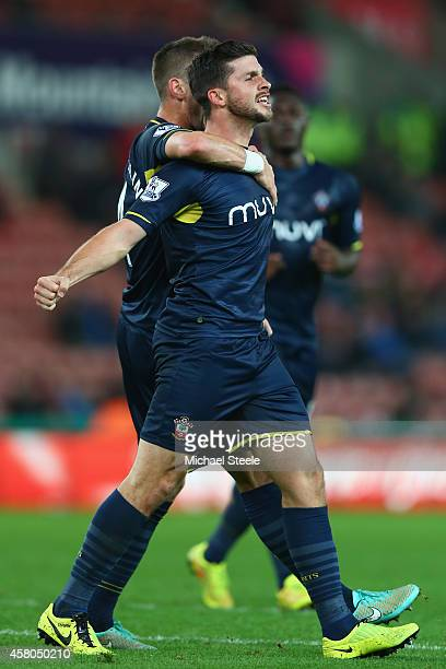 Shane Long of Southampton celebrates scoring his sides second goal with Morgan Schneiderlin during the Capital One Cup Fourth Round match between...