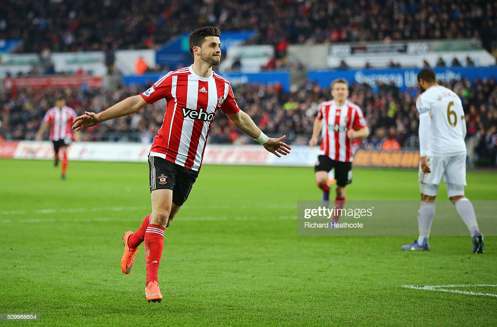 Shane Long of Southampton celebrates scoring his team's first goal during the Barclays Premier League match between Swansea City and Southampton at Liberty Stadium on February 13, 2016 in Swansea, Wales.