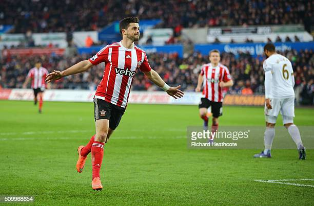 Shane Long of Southampton celebrates scoring his team's first goal during the Barclays Premier League match between Swansea City and Southampton at...