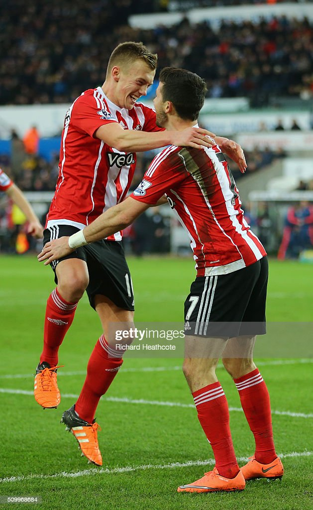 <a gi-track='captionPersonalityLinkClicked' href=/galleries/search?phrase=Shane+Long&family=editorial&specificpeople=661194 ng-click='$event.stopPropagation()'>Shane Long</a> (R) of Southampton celebrates scoring his team's first goal with his team mate James Ward-Prowse (L) during the Barclays Premier League match between Swansea City and Southampton at Liberty Stadium on February 13, 2016 in Swansea, Wales.