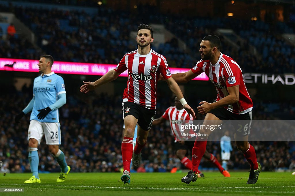 <a gi-track='captionPersonalityLinkClicked' href=/galleries/search?phrase=Shane+Long&family=editorial&specificpeople=661194 ng-click='$event.stopPropagation()'>Shane Long</a> (C) of Southampton celebrates scoring his team's first goalwith <a gi-track='captionPersonalityLinkClicked' href=/galleries/search?phrase=Steven+Caulker&family=editorial&specificpeople=6527106 ng-click='$event.stopPropagation()'>Steven Caulker</a> (R) during the Barclays Premier League match between Manchester City and Southampton at the Etihad Stadium on November 28, 2015 in Manchester, England.