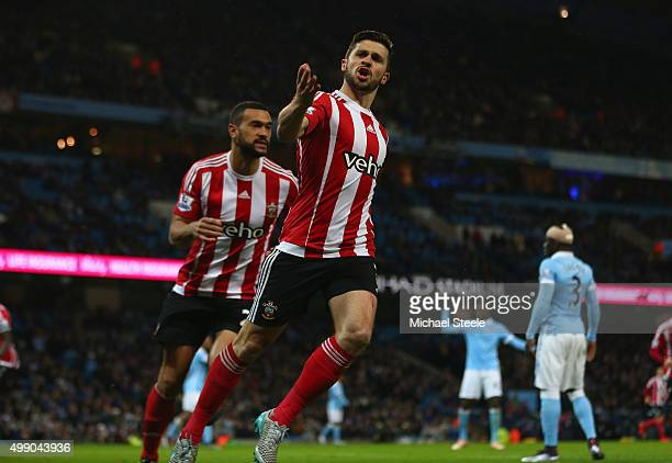 Shane Long of Southampton celebrates scoring his team's first goalwith Steven Caulker during the Barclays Premier League match between Manchester...