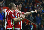 Shane Long of Southampton celebrates with Steven Davis as he scores their fourth goal during the Barclays Premier League match between Southampton...
