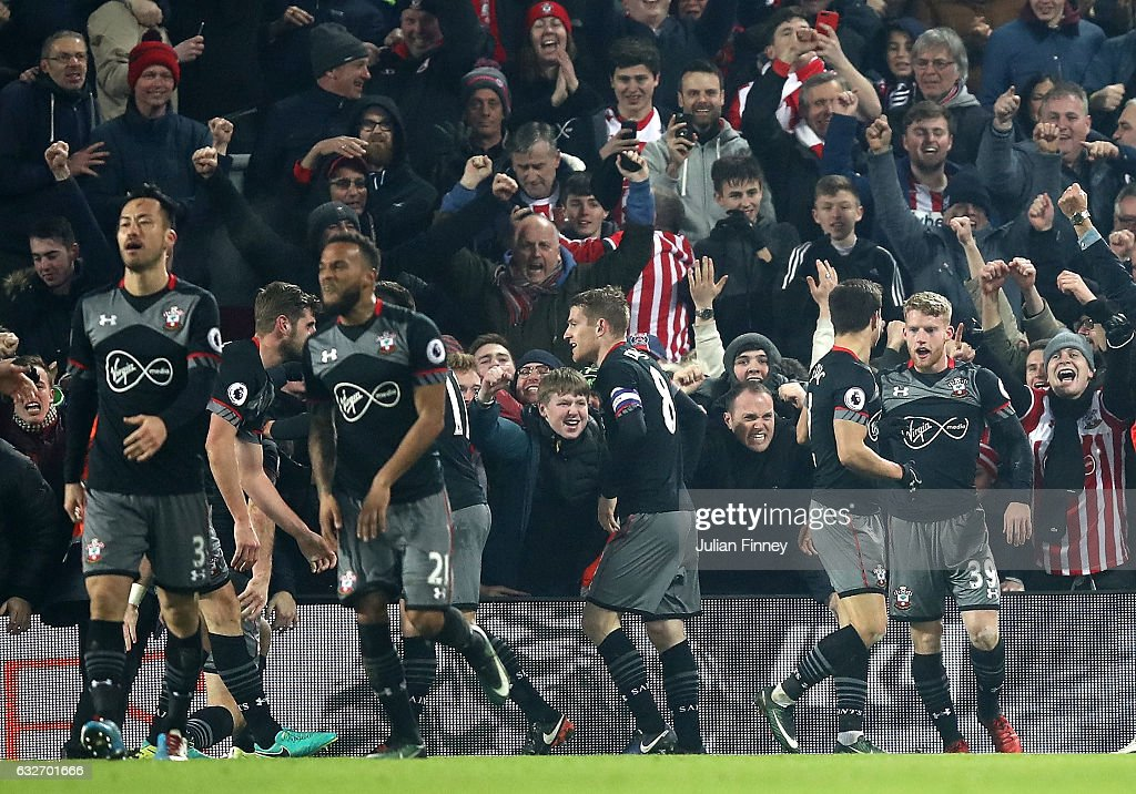Shane Long of Southampton (not pictured) celebrates with team mates after scoring his sides first goal during the EFL Cup Semi-Final Second Leg match between Liverpool and Southampton at Anfield on January 25, 2017 in Liverpool, England.