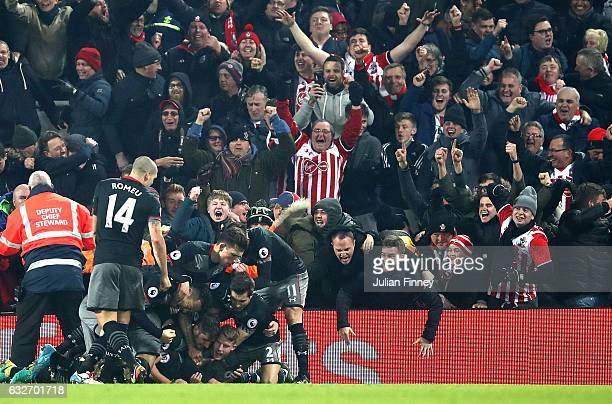 Shane Long of Southampton celebrates with team mates after scoring his sides first goal during the EFL Cup SemiFinal Second Leg match between...