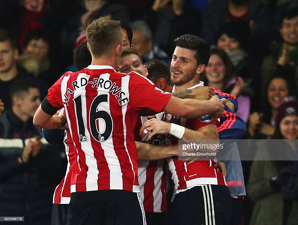 Shane Long of Southampton celebrates with team mates as he scores their second goal during the Barclays Premier League match between Southampton and...
