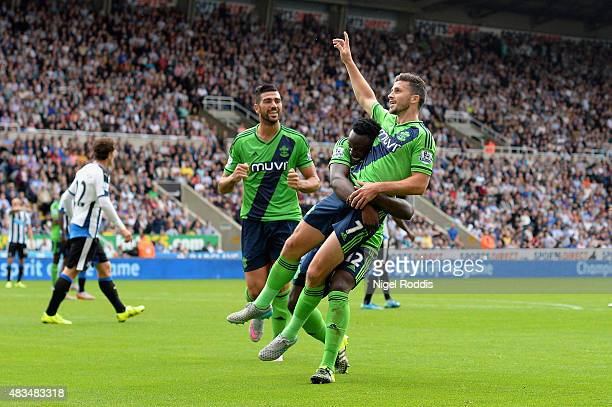 Shane Long of Southampton celebrates with Victor Wanyama and Graziano Pelle as he scores their second goal during the Barclays Premier League match...