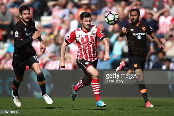 Shane Long of Southampton chases the ball under pressure from Andrea Ranocchia of Hull City during the Premier League match between Southampton and...