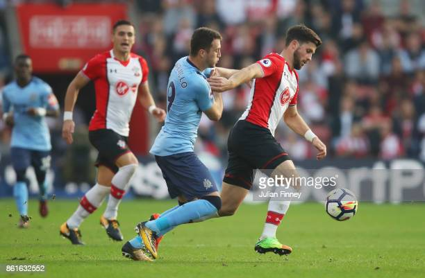 Shane Long of Southampton holds off Javi Manquillo of Newcastle United during the Premier League match between Southampton and Newcastle United at St...