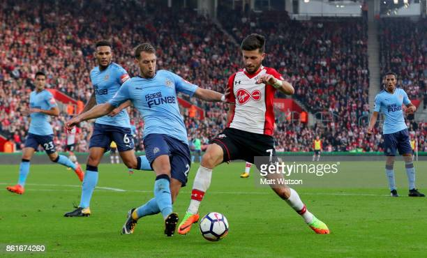 Shane Long of Southampton is brought down by Florain Lejeune to earn a penalty during the Premier League match between Southampton and Newcastle...