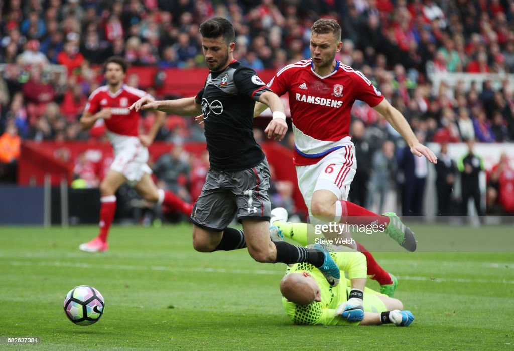 Shane Long of Southampton is fouled by Brad Guzan of Middlesbrough and a penalty is awarded to Southampton during the Premier League match between Middlesbrough and Southampton at Riverside Stadium on May 13, 2017 in Middlesbrough, England.