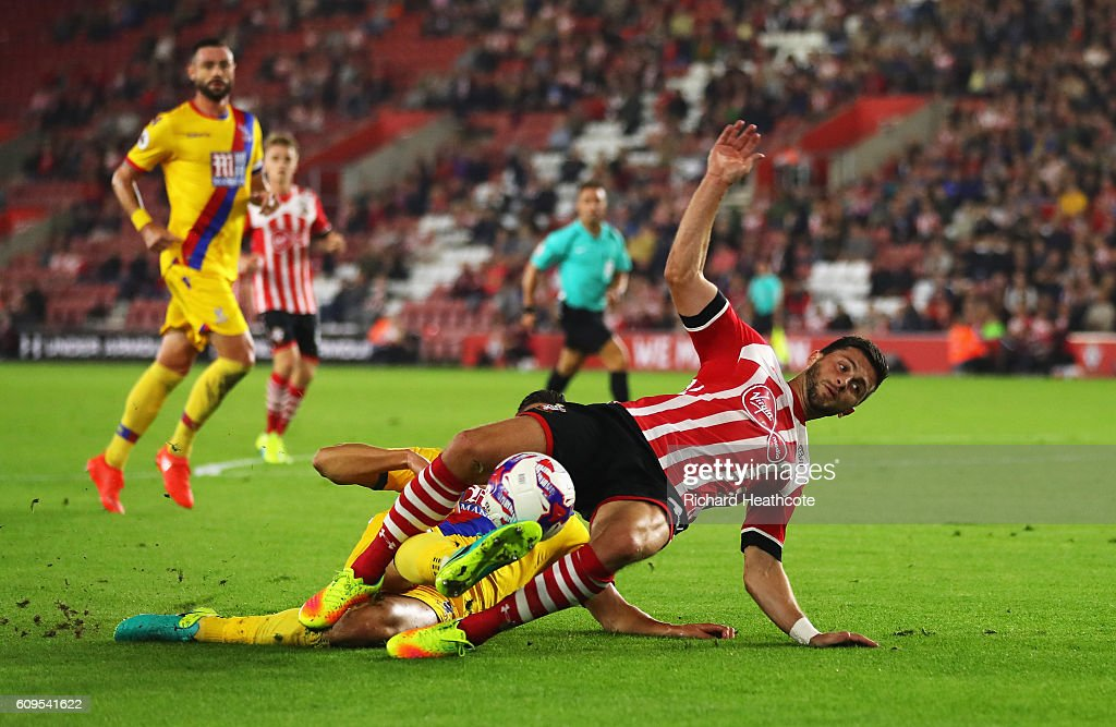 Shane Long of Southampton is fouled by Martin kelly of Crystal Palace inside the penalty area during the EFL Cup Third Round match between Southampton and Crystal Palace at St Mary's Stadium on September 21, 2016 in Southampton, England.