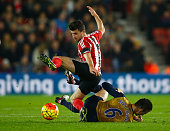 Shane Long of Southampton is tackled by Laurent Koscielny of Arsenal during the Barclays Premier League match between Southampton and Arsenal at St...