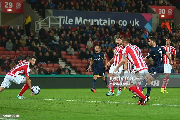 Shane Long of Southampton scores his sides second goal during the Capital One Cup Fourth Round match between Stoke City and Southampton at the...