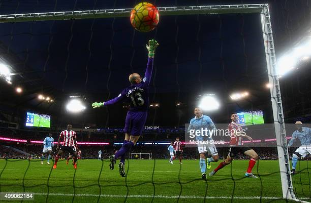 Shane Long of Southampton scores his team's first goal past Wilfredo Caballero of Manchester City during the Barclays Premier League match between...