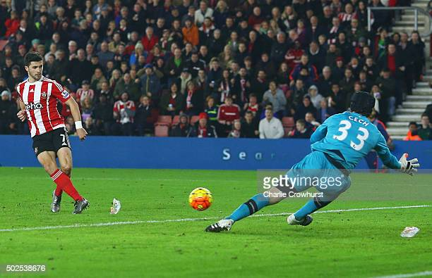 Shane Long of Southampton scores their second goal past goalkeeper Petr Cech of Arsenal during the Barclays Premier League match between Southampton...