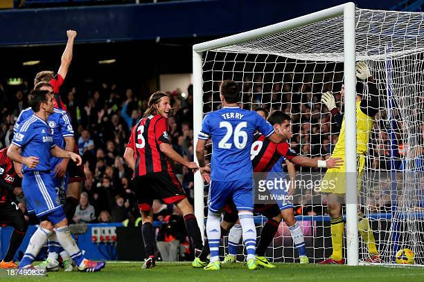 Shane Long of West Brom scores to level the scores at 11 during the Barclays Premier League match between Chelsea and West Bromwich Albion at...