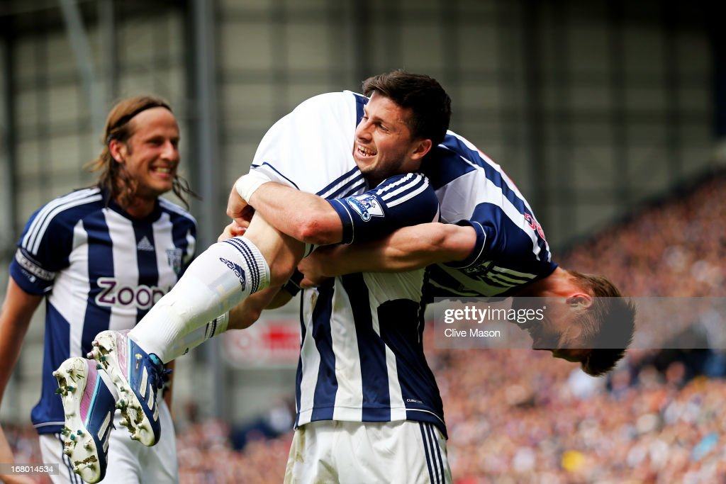 <a gi-track='captionPersonalityLinkClicked' href=/galleries/search?phrase=Shane+Long&family=editorial&specificpeople=661194 ng-click='$event.stopPropagation()'>Shane Long</a> of West Bromwich carries teammate Markus Rosenberg after scoring the opening goal during the Barclays Premier League match between West Bromwich Albion and Wigan Athletic at The Hawthorns on May 4, 2013 in West Bromwich, England.